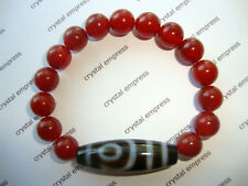 FENG SHUI - 2 EYE DZI WITH 10MM RED AGATE