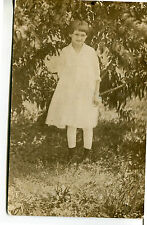 POST CARD OF A REAL PHOTOGRAPH OF A YOUNG GIRL IN BACK YARD ABOUT 1900