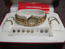 PEUGEOT LADIES WATCH WITH INTERCHANGEABLE BEZELS & STUDS MOTHER OF PEARL FACE
