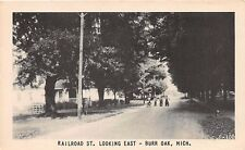 BURR OAK MICHIGAN RAILROAD STREET POSTCARD c1947 CHILDRENS ON BIKES WITH DOG