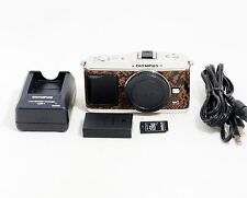 Olympus PEN E-P1 Digital Camera Body with the Items Shown