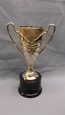 textured gold trophy plastic cup round black base