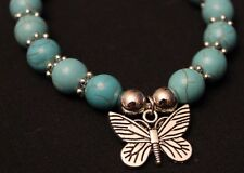 "Simulated Turquoise Stretch Bracelet with Silver-Tone Butterfly Charm, 7"" - 11"""