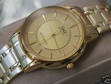 Nice Q&Q by Citizen Gold Toen Men's Dress Watch w/Golden Two Tone Dial