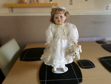 PORCELAIN DOLL IN PRETTY WHITE DRESS HOLDING TEDDY EXCELLENT CONDITION