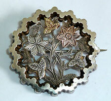 VICTORIAN UNMARKED SILVER FLOWER BROOCH WITH UNMARKED YELLOW & ROSE GOLD LEAVES