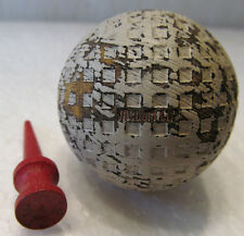 VINTAGE VACUUM CUP USED SQUARE MESH GOLF BALL AND A WOOD TEE BOTH CIRCA 1930'S