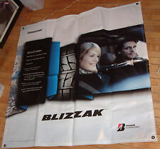 BRIDGESTONE BLIZZAK TIRES BANNER, 4' x 4'; NEW AND UNUSED