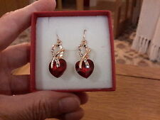 Brand new gold earrings  with ruby red crystal hearts and gift box