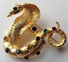 ALEXIS KIRK SIGNED RED GREEN BLUE AND CLEAR RHINESTONE COBRA SNAKE BROOCH