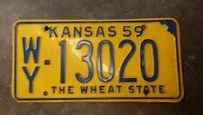 1959 KANSAS STATE LICENSE PLATE SOLID YELLOW NUMBER WY-13020 THE WHEAT STATE $45