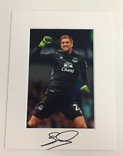 (1) An 8 x 6 inch mount with photo signed by Maarten Stekelenburg of Everton