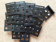 JOB LOT 10 pairs of 0.3 cm colour diamonte stud earrings. Silver plated.UK made.