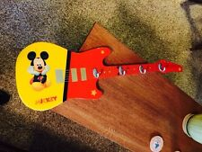 Mickey Mouse Guitar With Hooks Hangs On The Wall