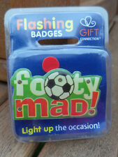 flashing pin badge/ fridge magnet new in original pack. 'FOOTY MAD'