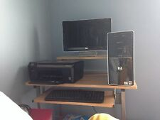 HP computer; black, comes with a very nice monitor, wireless printer, keyboard,