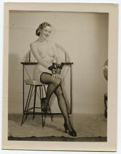 VINTAGE PHOTO WOMAN IN STOCKINGS, LACE GLOVES AND LONG EARRINGS.