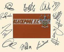 A 10 x 8 inch mount personally signed by 11 Blackpool players on 30.07.2016. (2)