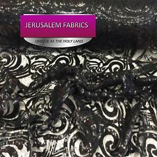 Sequins paysley design fabric mesh lace black. Sold by the yard.