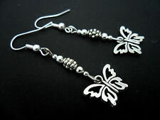 A PAIR OF DANGLY TIBETAN SILVER  BUTTERFLY EARRINGS. NEW.