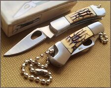 SMALL TOOTHPICK JIGGED BONE HANDLE FOLDING KNIFE W/ BEADED STAINLESS KEYCHAIN