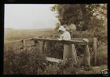 Glass Magic Lantern Slide EDWARDIAN LADY READING HIS LETTER ON A BRIDGE C1910
