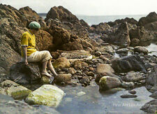 Gustave Gain autochrome photo, Woman at oceanside on rocks