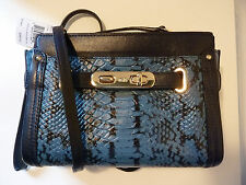 NWT COACH 64731 Swagger Wristlet in colorblock exotic embossed leather Navy