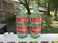 "Two Coca Cola 2 liter ""return for deposit"" bottles"