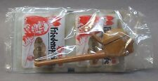 PEZ INDIAN PEACE PIPE in brown color.  unused.  MINT in sealed package w/ candy