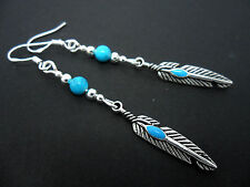 A PAIR OF TIBETAN SILVER FEATHER EARRINGS WITH 925 SOLID SILVER HOOKS. NEW..