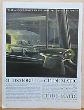1960 magazine ad for Oldsmobile & Guide-Matic headlight control