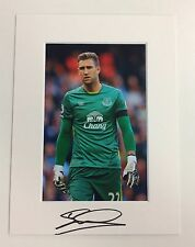 (2) An 8 x 6 inch mount with photo signed by Maarten Stekelenburg of Everton