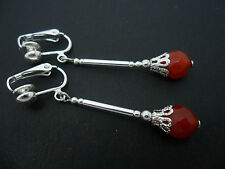 A PAIR OF SILVER PLATED RED JADE BEAD CLIP ON EARRINGS. NEW.