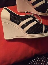 michael kors  Wedge Sneakers 8.5 Fabulous Black And White. New.unique.