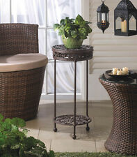 "CAST IRON PLANT STAND ROUND BROWN TWO SHELVES DECORATIVE 24 1/ 8"" TALL"