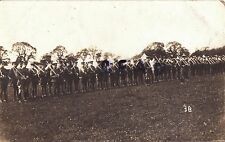 WW1 Norfolk Yeomanry on parade with swords drawn at Camp