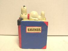 1958, 1968 Snoopy Laying on Piggy Bank Vintage Peanuts United Feature Syndicate