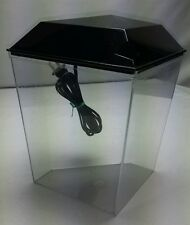 Used one gallon black plastic betta tank bowl with switched light.