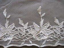 7 3/4 YDS IVORY FLORAL RAYON EMBRDROIDERED ON NYLON NET LACE.