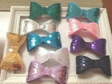 20 X 60/40M APROX  SEQUINED BOWS10 COLOURS 2 OF EACH COLOUR PRETTY