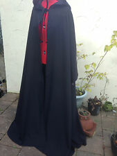 long black cloak with sleeves and a rounded hood. lined hood