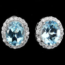 OVAL 9x7mm SKY BLUE TOPAZ Solitaire &W. CZ ACCENTS STERLING 925 SILVER EARRINGS