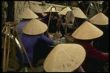 076033 People Squatting Wearing Cone shaped Hats A4 Photo Print