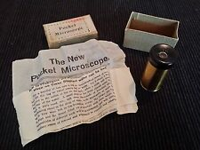 A 1930's Pocket Microscope with original box and instructions.