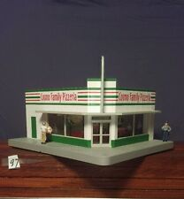 k-line cosmos family pizzeria lighted building with 3 figures