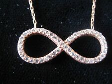 "INFINITY SIGN FILLED WITH ZIRCONIA in the middle of a free 18"" chain"