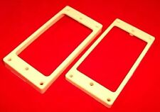 PAIR OF RADIUS BASE IVORY HUMBUCKER PICKUP SURROUNDS / FIT LES PAUL ETC