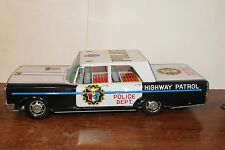 LARGE TIN LITHO FRICTION POWERED FORD HIGHWAY PATROL POLICE CAR with Siren