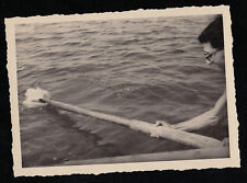 Vintage Antique Photograph Man Pulling Debris Out of Water With Boat Oar